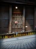 Urban Loading Zone Door. Industrial warehouse loading zone at night Stock Image