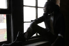 Urban Male. African American male sitting by the window Stock Photography