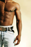 Urban male torso 2. African american male  in jeans on tan background Stock Photos