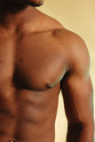 Urban male torso 3. African american male  close up on tan Stock Image
