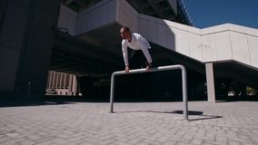 Urban man doing parkour in city stock footage