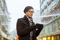 Urban man holdin tablet computer on street Royalty Free Stock Images