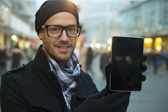 Urban man holdin tablet computer on street Stock Images