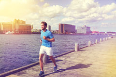 Urban man runner running in european city downtown Royalty Free Stock Photo