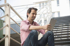 Urban man tablet Stock Photo