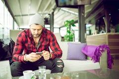 Urban man typing on smartphone Stock Image