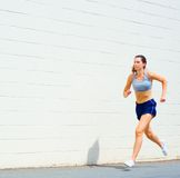 Urban Mature Woman Exercising. Mature woman working out in an urban setting, from a complete set of photos Royalty Free Stock Images