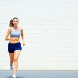 Urban Mature Woman Exercising. Mature woman working out in an urban setting, from a complete set of photos Royalty Free Stock Photos