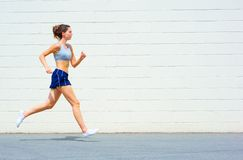 Urban Mature Woman Exercising. Mature woman working out in an urban setting, from a complete set of photos Stock Image