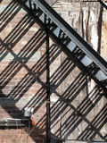 Urban Metal Stairs Shadow on a Wall Stock Images