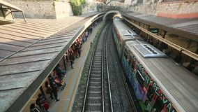 Urban metro station with subway train. ATHENS, GREECE - APR 13, 2015: Urban metro station with subway train. The Athens Metro is a rapid-transit system opened stock footage