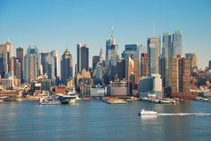 Urban metropolis city skyline. Manhattan with Empire State Building, New York City over Hudson River with boat and pier royalty free stock image