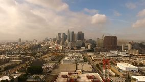 Urban Metropolis Los Angeles City Skyline Cloudy Blue Skies. Aerial view of Los Angeles warehouses and downtown stock footage