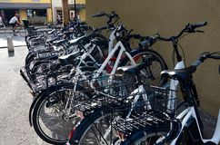 Bikes parked along a street in Geneva stock photography