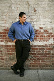 Urban Model 9. Latino background man leaning on a brick wall Stock Photography
