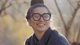 Urban Model Woman in Fashion coat and glasses Having Fun. Glamour Sexy Hipster Girl, Trendy Hairstyle in Autumm Streets stock footage