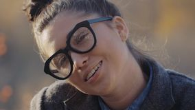 Urban Model Woman in Fashion coat and glasses Having Fun. Glamour Sexy Hipster Girl, Trendy Hairstyle in Autumm Streets stock video footage