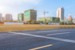 Urban modern buildings and roads. Empty asphalt road through modern city in China Stock Photos