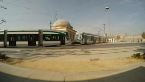 Urban modern tram rides near the ancient building in the center of Konya. KONYA / TURKEY - 11.20.2016 central streets of the ancient Turkish city stock footage
