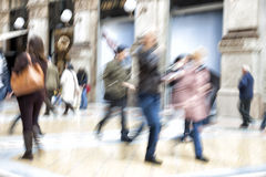 Urban move, people walking in city, motion blur, zoom effect Stock Photography