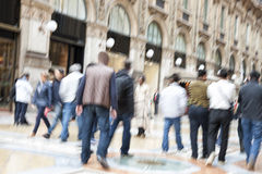 Urban move, people walking in city, motion blur, zoom effect Stock Image