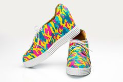Urban Multicolored Design & Camouflage Pattern Sneakers Crafted. From Durable Canvas, Women Fashion Work Out Or Lifestyle Active Wear Shoes Isolated On White Stock Image
