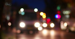 Urban night scene defocused. Blurred urban traffic stock video footage