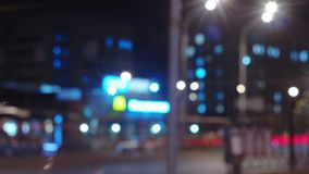 Urban night time lapse. Cars and pedestrians blurred defocused, long exposure stock video