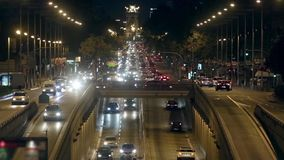 Urban night traffic in Barcelona.01. Urban night traffic in Barcelona: great avenue of entry and exit to the city stock footage