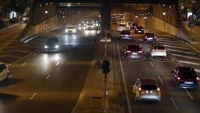 Urban night traffic in Barcelona.04. Night traffic in Barcelona: Urban tunnel stock video footage