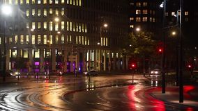 Urban night traffic. Urban traffic at night in falling rain stock video footage
