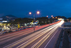 Urban night traffics with focus on the road. Stock Photos
