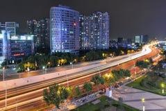 Urban Nightscape. Car light trail toward through the city, Shanghai Stock Image
