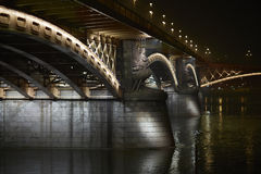Urban nightscape, illuminated bridge Stock Images