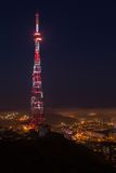 TV broadcasting tower at night stock photography