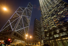 Urban Office Buildings. Steel building rise into the sky in this urban scene at night stock image