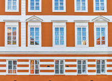 Urban orange building with blue window in the city Stock Image