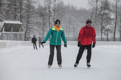 Urban outdoor ice rink in the park. Royalty Free Stock Photography
