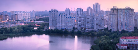Urban panorama. Highway near householder high rises on the lake Stock Photo