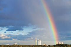 Urban panorama with rainbow Royalty Free Stock Images