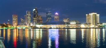 Urban Panoramic Downtwon City Skyline of Tampa Florida. Night falls as lights come up on buildings beginning a beautiful summer evening in Tampa Florida downtown stock images