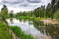 Urban park scene with cloudy stormy sky Royalty Free Stock Photography
