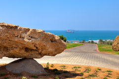Urban park with sea view in Ashdod, Israel. Sculptural composition made from heavy rock in urban park with beautiful view on Mediterranean sea in Ashdod, Israel stock photo