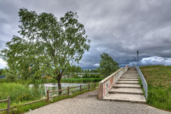 Urban park under cloudy stormy sky Royalty Free Stock Image