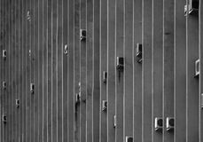 Urban Pattern. Office building with the air conditioners, fixed on the transverse construction edges. Black and white image royalty free stock photos