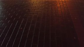 Urban pavement at night close up 4K steadicam video. Urban pavement close up 4K steadicam night video stock video footage