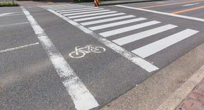 Urban pedestrian crosswalk across an asphalt road in city. Stock Photo