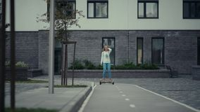 Urban people. Modern inhabitant of the big city. Riding on hoverboard. Urban people. Modern inhabitant of the big city. Young woman riding on electric scooter stock footage