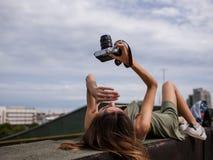 Urban photoshoot woman walk roof concept Stock Photos