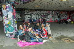 Urban picnic. Youth enjoying a picnic amongst the urban art on the South Bank during the Queen Elizabeth II Diamond Jubilee celebrations in London, UK on June 3 Stock Photography